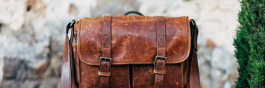 How can you protect yourself when wearing a messenger bag?